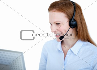 Radiant sales representative woman working on a computer