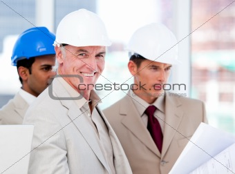 Smiling architect team working on a building project