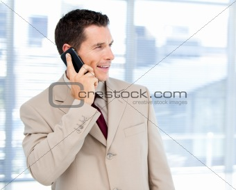 Charming businessman talking on phone standing