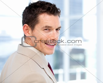 Smiliing businessman with headset on standing