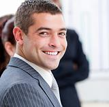 Close-up of a smiling businessman at a presentation