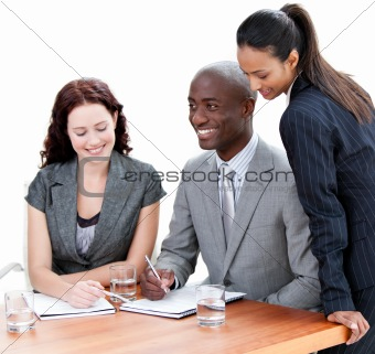 Business co-workers studying a document