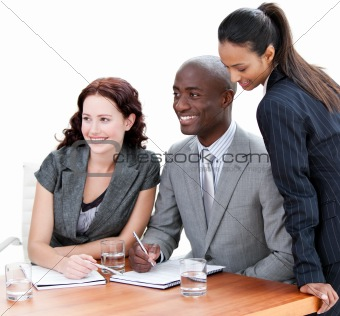 Positive business co-workers studying a document