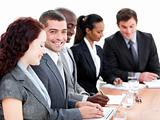 Assertive multi-ethnic business people in a meeting
