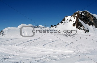 Alpine ski slope and skiers