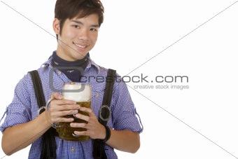 Handsome chinese man holding Bavarian Oktoberfest beer stein in Hands