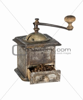 Old coffee grinder with coffee beans isolated