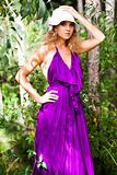 Young Woman in a Purple Dress Outdoors