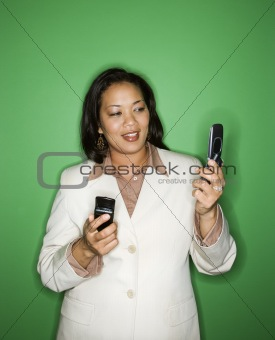Businesswoman with cellphones.