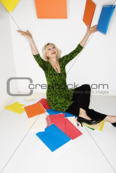 Businesswoman throwing folders