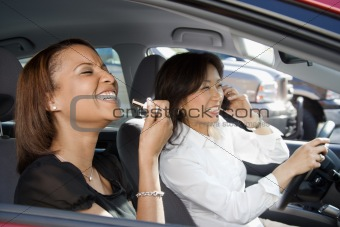 Laughing women in car.