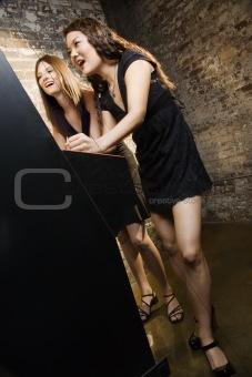 Girls playing video game.