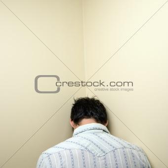 Man in corner