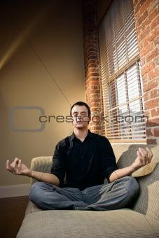 Man in lotus pose