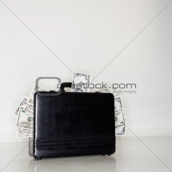 Briefcase overflowing with money
