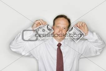 Businessman ripping money
