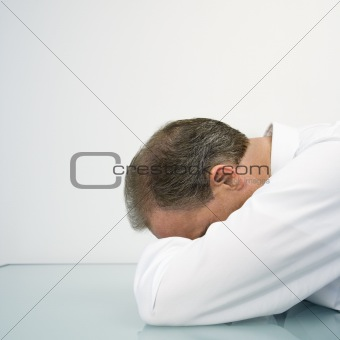 Businessman with head on desk