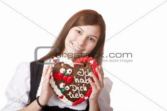 Bavarian woman in love holds Oktoberfest heart.