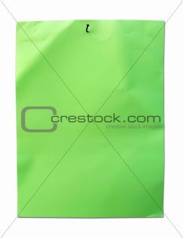 Green paper with nail