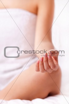 Close up shot of a young woman fingers while doing yoga