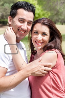 Closeup Portrait Of A Cute Couple Hugging