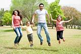 Family jumping together in the park