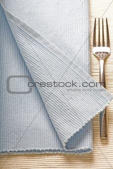 fork on blue napkin