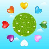 Balloons Around Grass Ball With Flowers