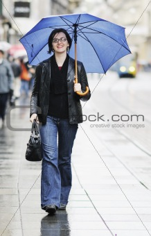 woman on street with umbrella