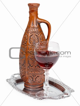 Ancient ceramic bottle with Georgians wine