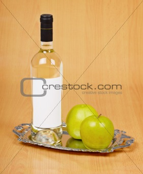 Apple wine in closed bottle on tray