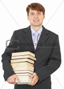 Portrait of man with big pile of books