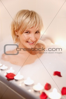 nude woman in foamy bath