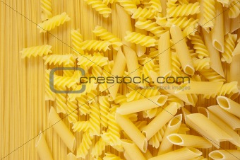 Background Macaroni on long spaghetti. Close up .
