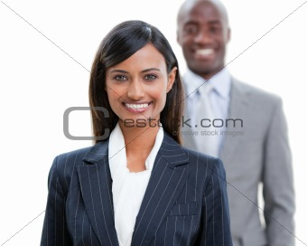 Smiling business people standing in a row