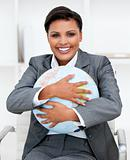 Charismatic businesswoman holding a terrestrial globe