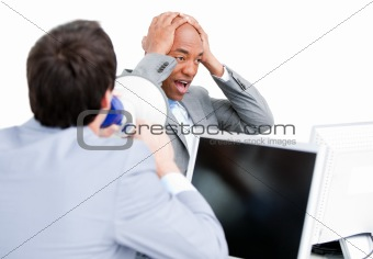 Angry young businessman yelling through a megaphone