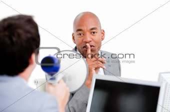 Afro-american businessman asking for silece while his colleague