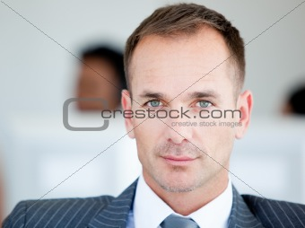 Handsome businessman looking at the camera