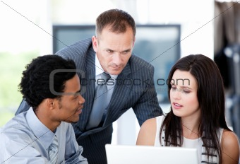 United businessteam working with the computer