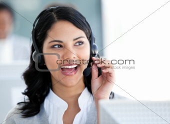 Beautiful businesswoman talking with clients in front of her com