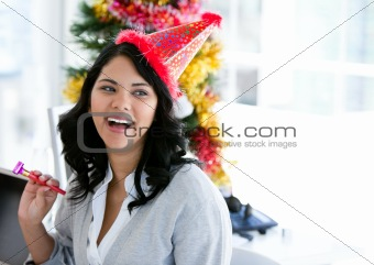 Positive businesswoman celebrating christmas