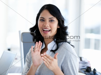 Portrait of a cute businesswoman applaudising a new colleague