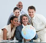 United businessteam holding a globe  globalization concept