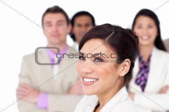Brunette female executive presenting her team