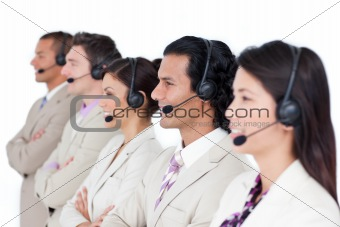 Confident business team lining up with headset on