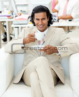 Charming manager drinking a tea