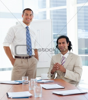 Smiling businessman giving a presentation