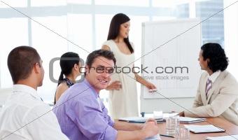 Beautiful businesswoman presenting figures