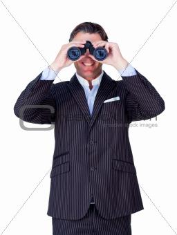 Smiling businessman looking through binoculars